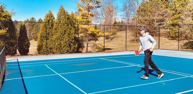 painting pickleball lines on a tennis court